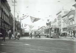 57-14713-Main-Street-North-July-4-Parade-Trolley-Cars