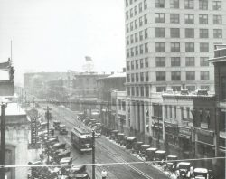 57-14721-Main-Street-In-Snow-Many-Cars-Old-Trolley