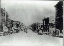57-14766-Main-St-Looking-North-Dirt-Streets-18885-1-of-2
